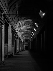 """When the tourists are gone"" (helmet13) Tags: bw italy architecture florence spotlight silence column nocturne emptiness portico aoi galleriadegliuffizi peaceaward heartaward leicaxvario"