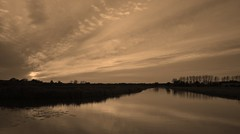 When the sky is changing (M a u r i c e) Tags: trees sunset sky sunlight nature water netherlands reflections pond horizon wideangle efs1022mm ultrawidezoom