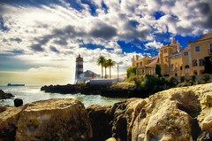 Portuguese landscapes (Alessandro Giorgi Art Photography) Tags: ocean sea summer sky panorama costa lighthouse west portugal water colors clouds buildings faro coast landscapes boat nikon rocks europa europe nuvole mare peace estate outdoor vessel atlantic nave cielo sassi rocce acqua coloured stillness portuguese paesaggio oceano portogallo atlantico costruzioni tranquillit colorato portoghese d7000