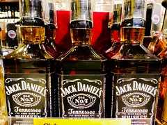 """If alcohol is a crutch, Jack Daniels is a wheelchair."" (Thad Zajdowicz) Tags: whisky alcohol whiskey drink spirits jackdaniels bottle label booze grocery store zajdowicz cellphone photoshopexpress motorola droid turbo smartphone 366 365 liquid display android mobile cameraphone indoor inside availablelight text writing letters words numbers 7 color brown amber glass container food attribution freeuse creativecommons lines curves"