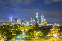 Downtown of Charlotte  North Carolina skyline (AgFineArtPhotography.com) Tags: city urban copyright skyline architecture night buildings nc twilight highway downtown cityscape view skyscrapers traffic charlotte officebuildings northcarolina scene architectural financialdistrict southern interstate charlottenc touristattraction centralbusinessdistrict copyrighted carolinas charlottenorthcarolina urbanscene businessdistrict traveldestination