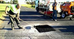 No.03-05 Working  on a damage area leveling the fresh asphalt 01-05-15