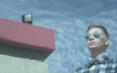 (Martyna Rat) Tags: boy male indie urban sky clouds blue red glasses blur noise filter lithuania portrait scenery landscape