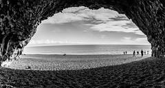 The Troll Cave on Reynishverfi Beach (mephistofales) Tags: caves iceland nordic roadtrip scandinavia basalt beach clouds blackandwhite bw panorama ocean water