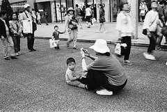 Ginza, Tokyo (fabiolug) Tags: kid child woman hat sitting people street streetphotography tokyo japan japanese asia leicamp leica mp rangefinder film filmphotography believeinfilm blackandwhite blackwhite bw kodaktrix400 trix400 kodak trix kodaktrix voigtlandernoktonclassic35mmf14 voigtlandernokton35mmf14 voigtlander35mmf14 35mm voigtlander