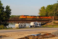 Rolling over the Mississippi river. (Machme92) Tags: railroad trees sky clouds river mississippi tracks rail trains bn missouri cannon rails ge bnsf railroads railroading railfanning gevo railfans trainrace hannibalsub bnsfkline burligrton