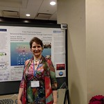 Psychology professor poses at research symposium.
