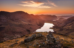 The long goodbye (Pete Rowbottom, Wigan, UK) Tags: uk light sunset red england sky cloud sun sunlight mountains nature water beautiful rural landscape still glow view sundown lakes lakedistrict warmth peaceful wideangle calm wainwright cumbria remote serene cairn goldenhour thelakes buttermere lakedistrictnationalpark englishlakes thelakedistrict fleetwithpike visitengland uklandscape peterowbottom nikond750