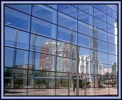 Salford Quays 14. On Reflection (Margaret Edge the bee girl) Tags: door blue windows light sky sun distortion glass lines wall architecture modern buildings reflections manchester outdoors lights towers salfordquays bbc mediacentre