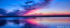 Casey Jones you better watch your speed (Kathryn Louise18) Tags: sunrise sunset water sky colors purple blue pink canon florida boat landscape