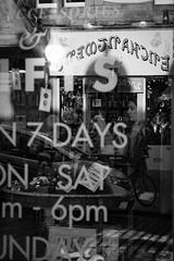 Window (kateburgoynephotography) Tags: edinburgh street photography black white canon eos people shop reflection