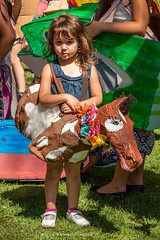 Woah Nelly (Facundity) Tags: offcenterfolkartfestival albuquerque albuquirky newmexico horse costume papermache papiermch child canoneos70d streetphotography naturallight robinsonpark folkart outdoor elbows