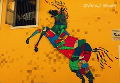 The famous street painting of #kalaghoda with different vivid #colours #shape #design.. (canon_graphy (ViraJ ShaH)) Tags: horse india streetart design colours vivid mumbai shape blackhorse kalaghoda streetpainting kalghodhafestival