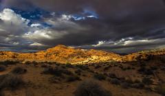 Desert storm (Fred Moore 1947) Tags: sky clouds sunrise landscape rocks desert nevada valleyoffirestatepark