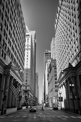 Small Man in the Big City (Lorenzo Mazzotti) Tags: street city bw usa white chicago man black canon photography eos photo reflex big small windy 6d 24105
