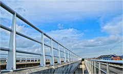 Stainless Steel (Hindrik S) Tags: bridge blue sky architecture clouds concrete vanishingpoint stainlesssteel iso400 sony rail bluesky viaduct handrail paintshoppro brug railing tamron brcke 16mm beton leeuwarden depht a57 2016 diepte 11000 liwwadden x8 leuning ljouwert brge verdwijnpunt f110 16300 sonyalpha sonyphotographing djipte kh2018 slta57 57 tamronaf16300mmf3563dillvcpzdmacrob016 ferdwynpunt
