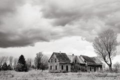 The Hunter's House [Explored] (/ shadows and light) Tags: old trees bw house storm abandoned monochrome grass clouds rural countryside quebec decay canterbury textures derelict decayed notrespassing bown ruralexploration rurex trixgrain chasseurlafft hunteronthelookout