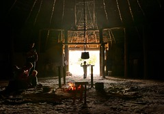 Young Beowulf returns? (Englepip) Tags: roundhouse beowulf ironage house butserancientfarm research family silhouette hearth light roof primitive fire warrior shadow highlight warmth pot chain polescooking stool iron thatch history museum archaeology experimental