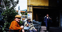 Be wary of the kind stranger with the camera (PaoloPiaggiPhoto) Tags: street people woman man streets color colour men film colors photography photo colorful strada colours fuji foto streetphotography fujifilm fotografia xt1