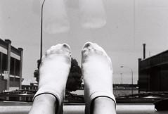 F1220020 (jdb.ashton) Tags: travel blackandwhite bw film feet window car socks toes driving pentax transport streetphotography australia monochromatic adventure journey perth dashboard analogue filmphotography