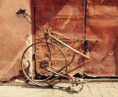 Hard wired bicycle, Marrakesh (Hammerhead27) Tags: road street door bicycle wheel electric trash wire junk rust lock cable frame