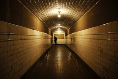 (cherco) Tags: city light man colour station yellow composition canon dark out vanishingpoint alone escape darkness metro corridor ciudad estacion 5d lonely metropolitan solitario reflejos composicion markiii