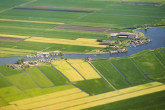 20160518_F0001: The typical Dutch countryside (wfxue) Tags: houses netherlands windmill plane river landscape boats countryside canal miniature aerial farmland illusion fields roads agriculture diorama waterway tiltshift passengerplane passengerjet windowsit