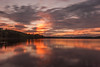 Sunset Ray (G_Howold) Tags: sunset light sweden nature outdoor ray clouds evening orange canon 20d travel landscape water long exposure weather colour colourful stand exquisitesunset