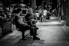 Story Teller (SarahJKelleher) Tags: street streetphoto streetphotography monochrome bnw blackandwhite men candid toronto ontario canada light shadow shadows night noflash urban city