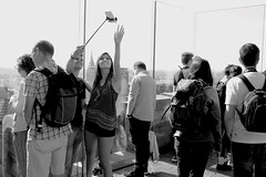 Top Of The Rock Selfie People 3 (andyfpp) Tags: fuji fujifilm x100t newyork nyc newyorkcity blackandwhite bw bwred mono monochrome monotone selfie stick iphone rock topoftherock shadows rockefeller
