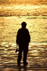 The Photographer IV (Rommel Parada) Tags: westmeadowbeach stonybrookny newyork suffolkcounty longisland northshore beach shore sea atlanticocean longislandsound water coast sunset goldenhour lowtide gold sand waves silhouette zoomlens candid inspirational evening photography photo camera exploration artistic reflection curious waiting people man person lightandshadow monochrome spectator observer light smithtownbay