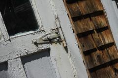 Garage Hinge (lefeber) Tags: door hinge wood newyork window architecture rural town rust shadows village garage shingles worn peelingpaint smalltown angled hudsonvalley rustymetal highlandfalls