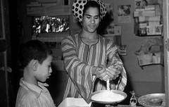 03_Luxor - Grocery Store 1955 (usbpanasonic) Tags: boy man northafrica muslim islam harvest egypt culture nile grocerystore nil luxor trade picking egypte islamic  moslem egyptians misr qahera masr egyptiens kahera