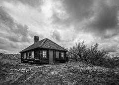 The beach hut (grbush) Tags: sky bw beach monochrome clouds coast blackwhite dunes norfolk shed hut beachhut blakeney blakeneypoint tokinaatx116prodxaf1116mmf28 sonyslta77