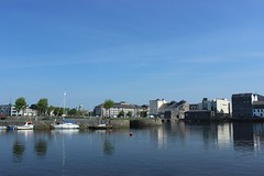 The View from Claddagh. (mcginley2012) Tags: claddagh water corrib quayside galway ireland reflection trees city boats buoy seagull swan cathedral people buildings bridge thespanisharch buoyant