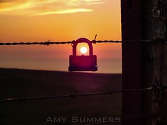 Guardian Of The Sun (amysummers) Tags: sunset sun colors wales clouds photography evening photo wire colours fuji photographer amy dusk great north photograph finepix fujifilm colourful padlock barbed llandudno summers orme exr hs30