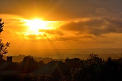 sunset at the valleys (doods-on-and-off) Tags: sunset clouds sunrays rooftops roofs mountains valleys sky yellow orange