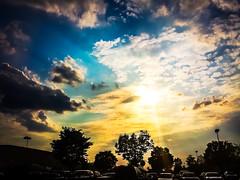 Day 125 - Sunbeams (artkeh) Tags: trees sunset sky sun cars clouds parkinglot sunbeams 2015 project365
