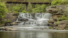Tanners Falls_1 (William_Doyle) Tags: bridge trees green nature water creek photoshop river waterfall rocks stream cloudy brook honesdalepa topazdenoise tannersfalls topazclarity may2016