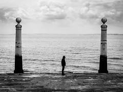 Three Pilars - Lissabon, Portugal (Sebastian Bayer) Tags: street sea sky blackandwhite bw man water clouds contrast river three meer wasser waves lisboa dramatic wolken olympus symmetric sw mann lissabon pillars fluss kontrast tajo omd drei wellen atlantik sulen schwarzweis dramatisch threepillars 124028 omdem5ii