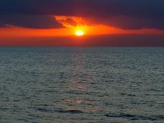 Evening fire (KerKaya) Tags: leica blue light sunset red sea sky orange sun seascape france nature water colors clouds reflections landscape lumix fire evening coast waves calm panasonic shore serenity normandy fz200 kerkaya