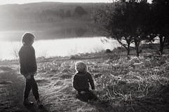 Those two (Dalla*) Tags: people bw white black wool nature grass kids children outside outdoors iceland sweater brothers dry area reykjavk hafnarfjrur landcape icelandic hvaleyrarvatn dallais