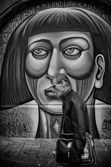 face to face graffiti (Daz Smith) Tags: city uk portrait people urban blackandwhite bw streets art blancoynegro monochrome wall canon graffiti blackwhite bath candid citylife thecity streetphotography sprayart canon6d dazsmith bathstreetphotography
