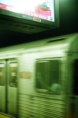 (Ali Seglins) Tags: city travel urban toronto ontario canada motion blur green film car television night analog speed train 35mm dark underground subway gold iso200 moving tv kodak ttc fast screen fluorescent transit canona1 bloordanforth aliseglins