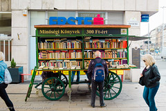 The Book Cart (gwpics) Tags: people person hungary budapest streetphotography lifestyle books literature cart bookshop society socialdocumentary hungarian socialcomment streetpics strasenfotograpfie