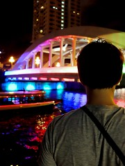 Overlooking. (brinthaloganathan) Tags: nightphotography reflection night reflections boats singapore colours nightscape boatquay clarkequay singaporeriver