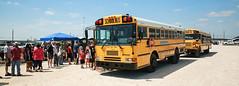 Finally, Buses (wyojones) Tags: texas deerpark houston sanjacintobattlefieldstatehistoricalpark sanjacintoday sanjacintobattlereenactment parking lines people wait frustration shelllot wyojones
