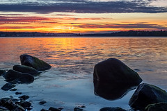 Setting (Jens Haggren) Tags: olympus em1 sun sunset setting sky clouds colours sea seascape water reflections landscape rocks boat swans evening nacka sweden hdr