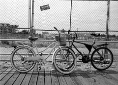 Boardwalk Bikes (Dalliance with Light) Tags: oceangrove bicycle boardwalk asburypark standdevelopment nikonfm2 street bw tmax400 film fence neptunetownship newjersey unitedstates us