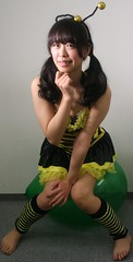 Sure, She's Sitting. Softly. (emotiroi auranaut) Tags: girl cute adorable teen teenage teenager play playing playful mischief mischievous sitting green toy balloon squeak bee costume cosplay asia asian japan japanese pretty sneaky charming attractive sit suspense tease teasing face hair ponytails legs feet toes barefoot foot risk risky pop burst